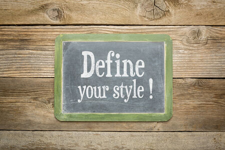 define: define your style advice on a  slate blackboard against rustic weathered wood planks