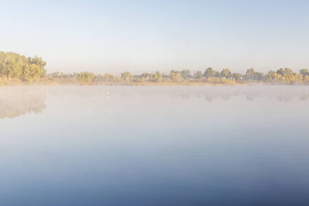 collins: foggy lake on a cold fall morning, RIverbend Ponds Natural Area, Fort Collins, Colorado