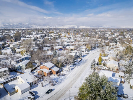 collins: cityscape with first snow - aerial view of a residential area of Fort Collins, Colorado from a low flying drone