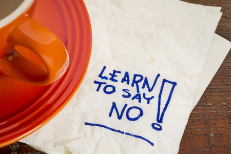 learn to say no advice - handwriting on a napkin with cup of coffee 스톡 콘텐츠