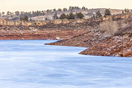 horsetooth reservoir: frozen lake with red cliffs - Horsetooth Reservoir near Fort Collins, Colorado