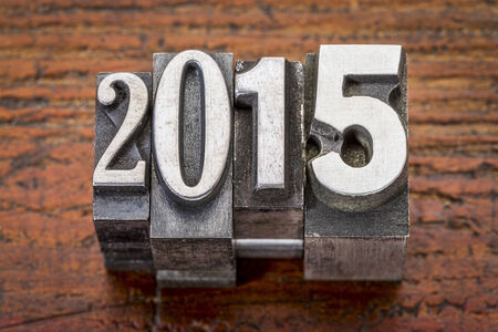 2015  - New Year concept  - text in vintage metal type over gungre wood photo