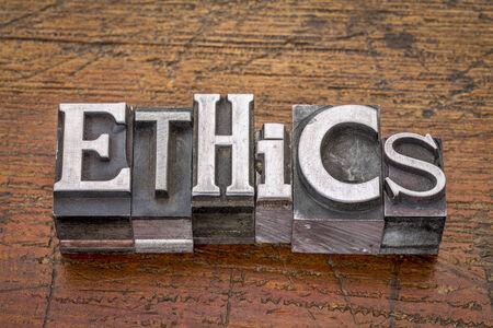 ethics: ethics  word in mixed vintage metal type printing blocks over grunge wood