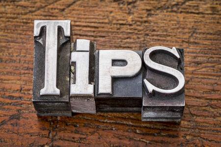 tips story word in vintage metal type printing blocks over grunge wood Stock Photo