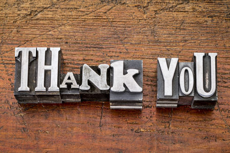 thank you - words in vintage metal type printing blocks over grunge wood, mixed fonts in style and size Banco de Imagens