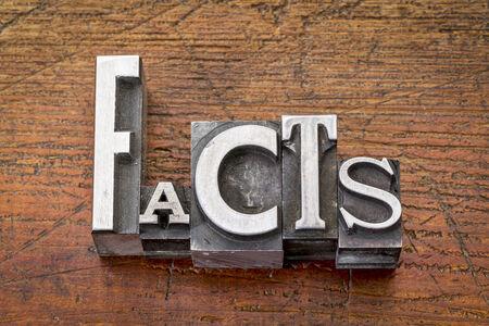 facts word in vintage metal type printing blocks over grunge wood