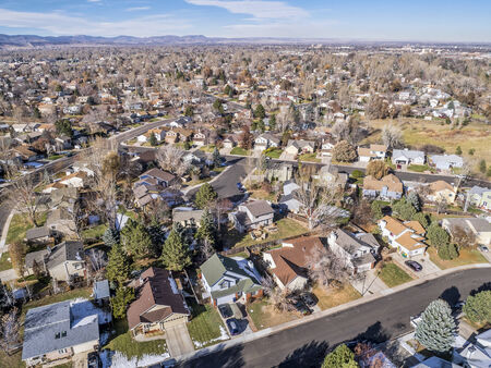 front range: cityscape of a typical residential area along Colorado Front Range - aerial view of Fort Collins  from a low flying drone, foothills of Rocky Mountains in background Stock Photo