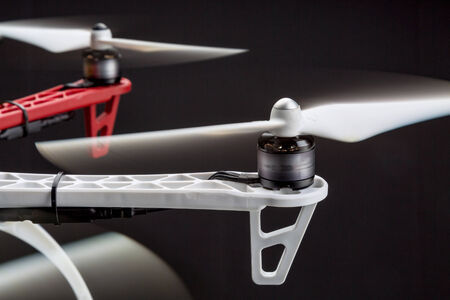 rotating propellers of a hexacopter drone against black background