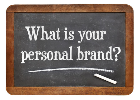 What is your personal brand  question on a vintage slate blackboard Standard-Bild