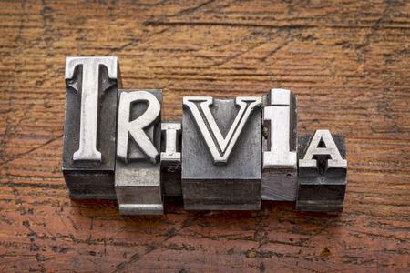 trivia word in vintage metal type printing blocks over grunge wood