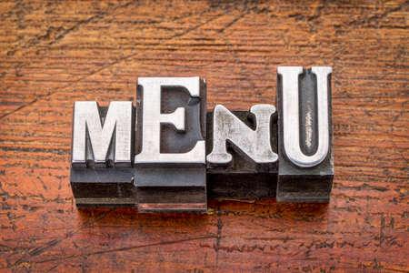menu word in vintage metal type printing blocks over grunge wood photo
