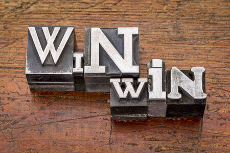 win-win strategy in mixed vintage metal type printing blocks over grunge wood