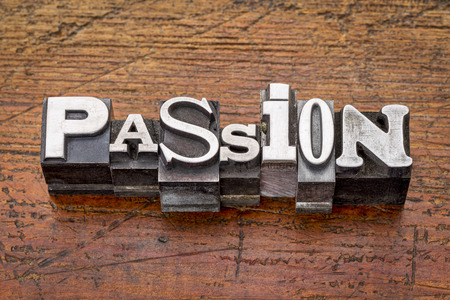 passion word in mixed vintage metal type printing blocks over grunge wood photo