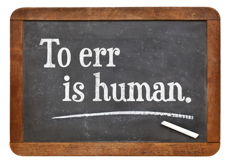 err: to err is human - a quote by English writer Alexander Pope - text on a vintage slate blackboard