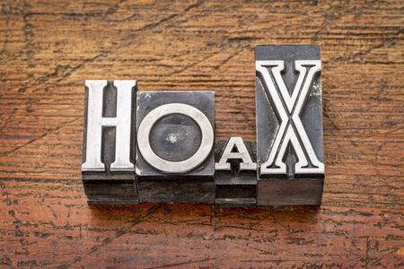 hoax: hoax word in mixed vintage metal type printing blocks over grunge wood Stock Photo
