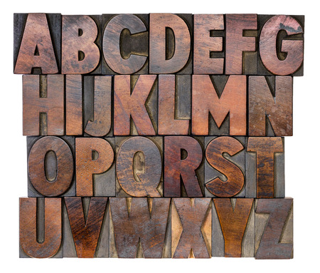English alphabet in letterpress wood type printing blocks, stained by color inks 스톡 콘텐츠