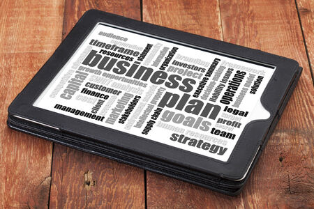 timeframe: business plan word cloud on a digital tablet against weathered wood Stock Photo