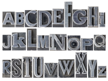 letterpress letters: English alphabet - a collage of 26 isolated letters in letterpress metal type printing blocks, a variety of mixed fonts
