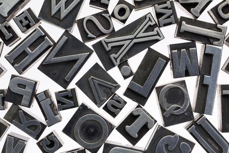letterpress letters: random letters in vintage letterpress metal type against white background