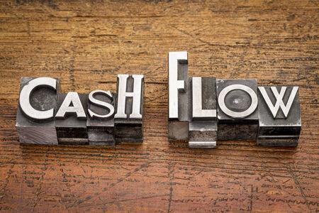cash flow words in mixed vintage metal type printing blocks over grunge wood photo