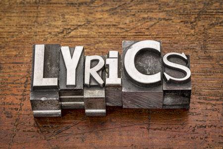 lyrics: lyrics word in mixed vintage metal type printing blocks over grunge wood