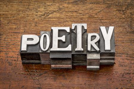 poetry word in mixed vintage metal type printing blocks over grunge wood