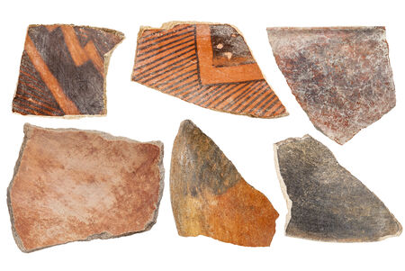 indian artifacts: ancient Native American Indian (Anasazi) artifacts, six pottery shards  isolated on white Stock Photo