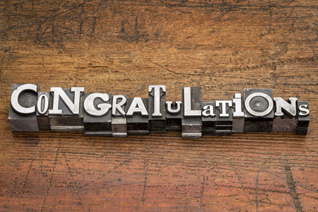 acknowledgment: congratulations  word in mixed vintage metal type printing blocks over grunge wood