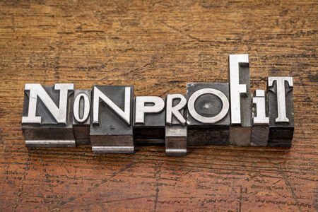 nonprofit: nonprofit word in mixed vintage metal type printing blocks over grunge wood Stock Photo