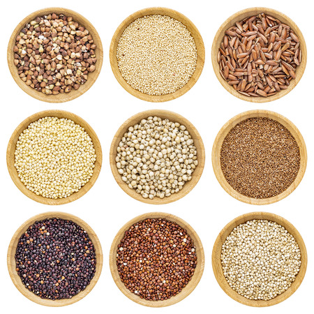 millet: gluten free grains  - buckwheat, amaranth, brown rice, millet, sorghum, teff, black, red and white quinoa - isolated wooden bowls