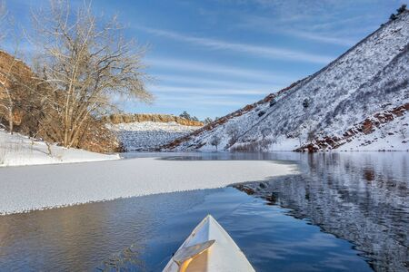 fort collins: winter canoe paddling on Horsetooth Reservoir near Fort Collins in northern Colorado