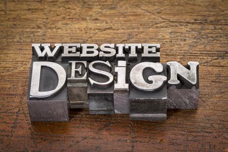 website design text in mixed vintage metal type printing blocks over grunge wood photo