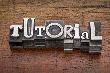 tutorial word in mixed vintage metal type printing blocks over grunge wood