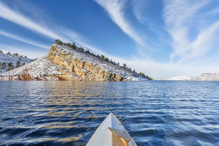 horsetooth reservoir: canoe paddling on Horsetooth Reservoir near Fort Collins in northern Colorado, winter scenery