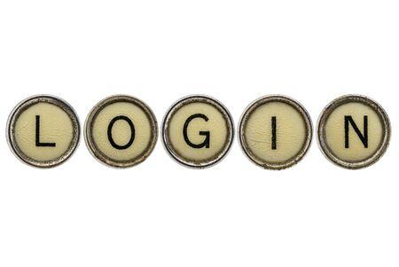 login word in old round typewriter keys isolated on white Reklamní fotografie