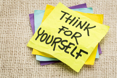 yourself: think for yourself advice on a sticky note against burlap canvas