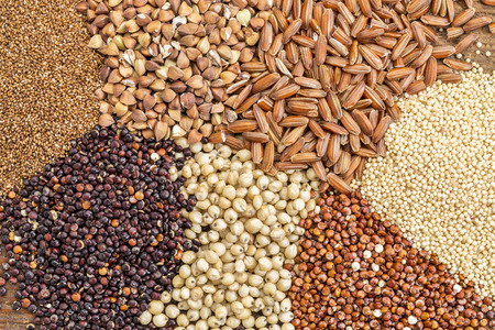 healthy grains: a variety of gluten free grains (buckwheat, amaranth, brown rice, millet, sorghum, teff,  red quinoa) i- top view