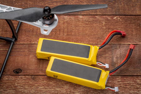 abbreviated: Two lithium-ion polymer rechargeable battery (abbreviated as LiPo, LIP, Li-poly) with balancing and main power plugs. LiPo batteries are used in portable electronics, drones and radio controlled models. Stock Photo