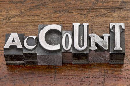 account word in mixed vintage metal type printing blocks over grunge wood photo