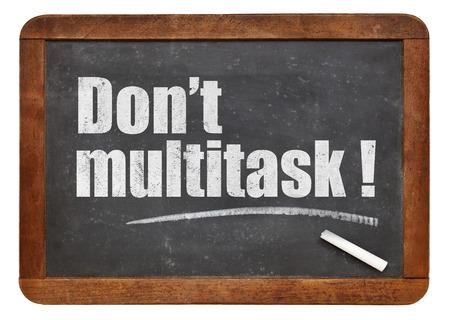 Do not multitask!  - white chalk text  on a vintage slate blackboard