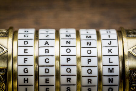 secret code: ebook word as a password to combination puzzle box with rings of letters Stock Photo