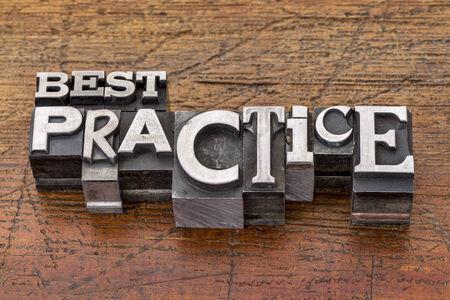 best practice words in mixed vintage metal type printing blocks over grunge wood
