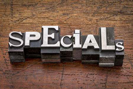 specials word in mixed vintage metal type printing blocks over grunge wood Stock Photo