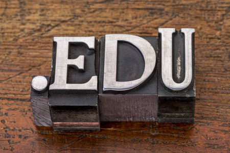 edu: education internet  domain - dot edu in mixed vintage metal type printing blocks over grunge wood