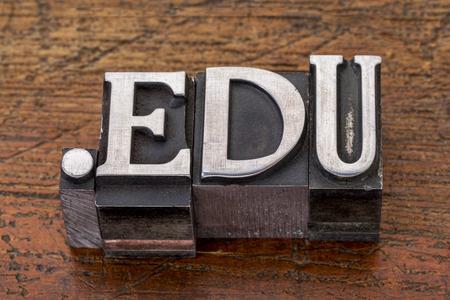 education internet  domain - dot edu in mixed vintage metal type printing blocks over grunge wood