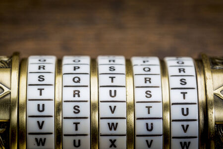 secret code: trust word as a password to combination puzzle box with rings of letters Stock Photo