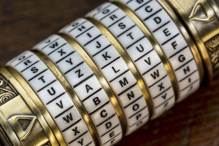 secret code: value word as a password to combination puzzle box with rings of letters Stock Photo
