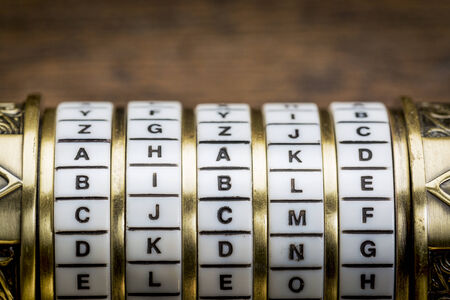 bible word as a password to combination puzzle box with rings of letters Stok Fotoğraf