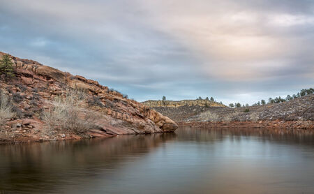 horsetooth reservoir: calm dusk over a lake with redstone cliffs - Horsetooth Reservoir near Fort Collins in northern Colorado