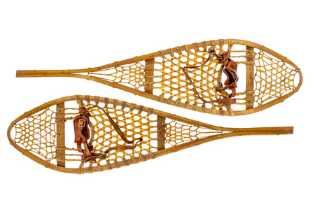 rawhide: a pair of vintage wooden Huron snowshoes with leather binding isolated on white Stock Photo